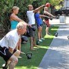 Our outdoor bootcampers swinging kettlebells.