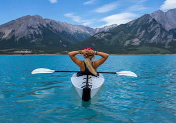 Woman_Kayaking_Mountain_Lake